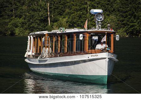 KOENIGSSEE, GERMANY - AUGUST 13, 2015: Electric pleasure boat operating on the Koenigssee lake and commute between Schoenau St. Bartholomew and Salet