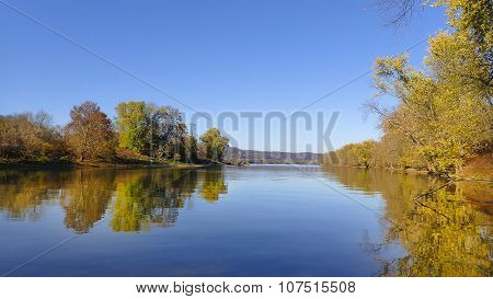 River Landscape with Autumn or Fall Tree Foliage.