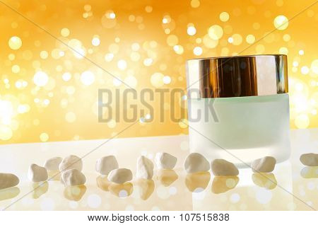 Moisturizer Concept Jar Closed Yellow Bokeh Background With Small Stones