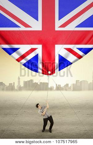 Man Drags Flag Of United Kingdom