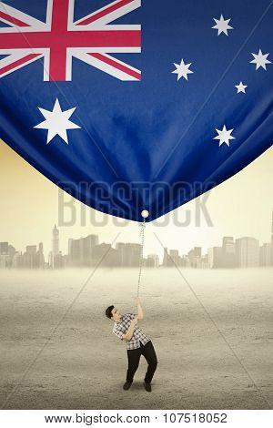 Man Pulling Australian Flag