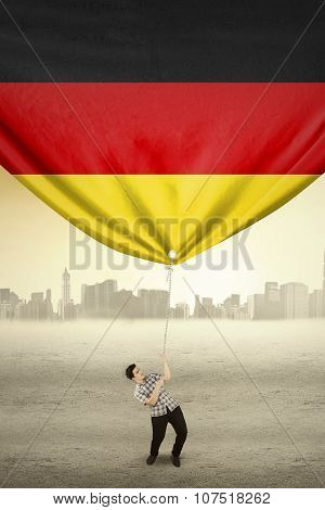 Man Pulling Flag Of German