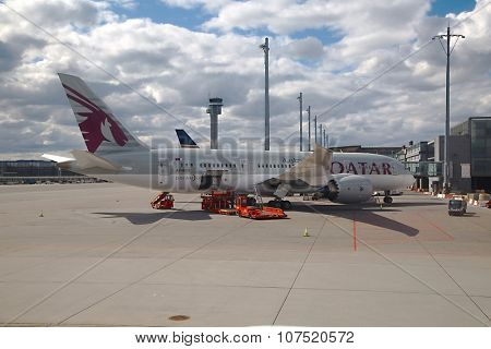 OSLO, NORWAY - MAY 3, 2015: Qatar Airways Dreamliner ready for boarding at Oslo Gardermoen airport.