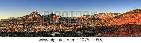 Birds eye panorama of the city of Sedona, Arizona and the Red Rocks at sunset