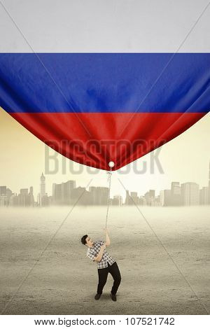 Young Person Pulling Flag Of Russia