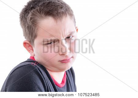 Portrait Of Boy With Scrutinizing Expression