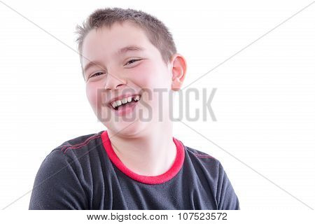 Young Boy With Braces On Teeth Laughing In Studio