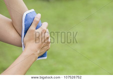 Woman Putting An Ice Pack On Her Elbow Pain