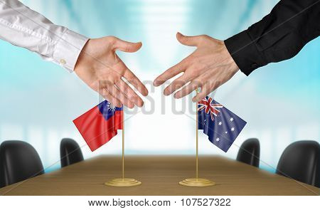 Taiwan and Australia diplomats agreeing on a deal