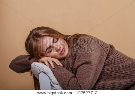 Girl In A Warm Sweater Fell Asleep.