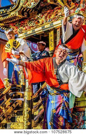 Matsuri men welcoming crowds