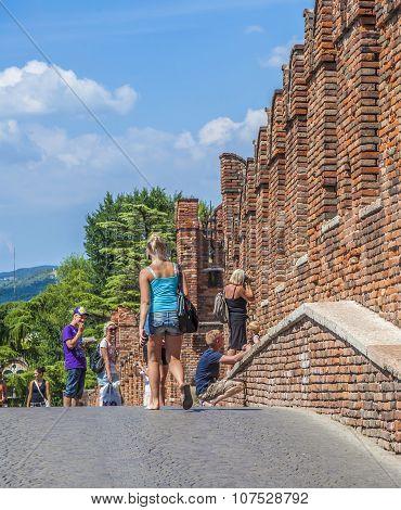 People Visit Castelvecchio In Verona, Italy