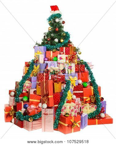 Lot of gifts are lying under Christmas tree