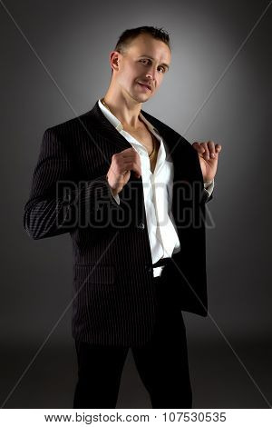 Shot of handsome man in business suit with stripes