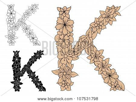 Dainty floral letter K with decorative foliage