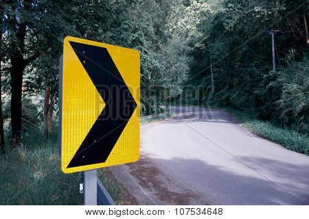 Yellow black Arrow sign banner on the road