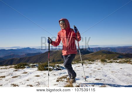 Athlete Runs In The Winter In The Mountains.