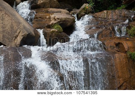 Close up of a waterfall over the rocks