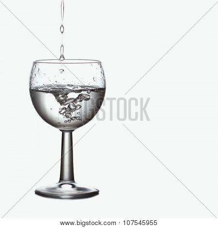 Pour, splash in natural clear water glass. relax spa ecologiac concept. Frozen motion. soft focus, m