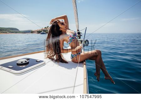 Sexy Girl In Swimwear On Yacht In Tropics