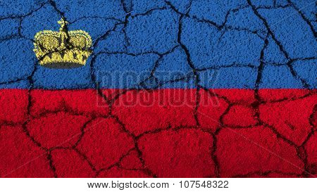 Liechtenstein flag painted on cracked ground