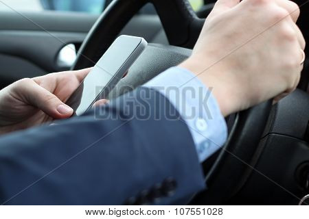 The Businessman Using Mobile Smart Phone While Driving The Car