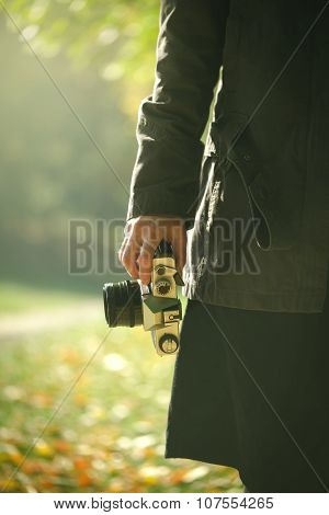 Hipster Female Photographer Exploring Autumn Nature Scenery