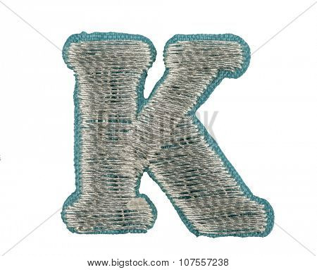Fonts that are stitched with thread isolated on white capitol letter K