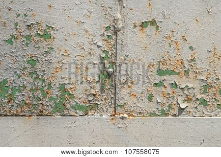 iron surface is covered with old paint texture background