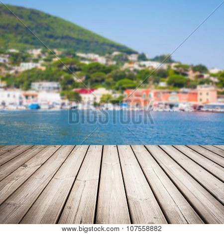 Empty Wooden Pier With Blurred Landscape