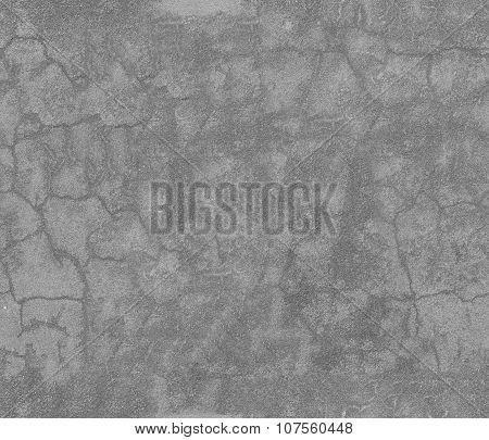 Old asphalt bitumen texture with cracks tiled.
