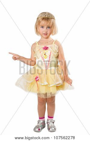 Little Girl In A Beautiful Yellow Dress  Pointing His Finger On A White Background.