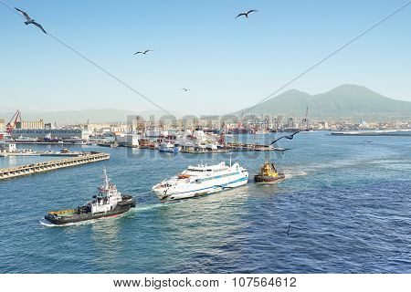 Aerial View Of Napoli Industrial Skyline And Vesuvius With Tugboat towing Shipwreck