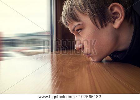 Sad Teenager Look At Window