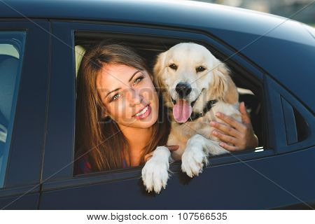 Woman And Dog In Car. Vacation With Pet Concept.