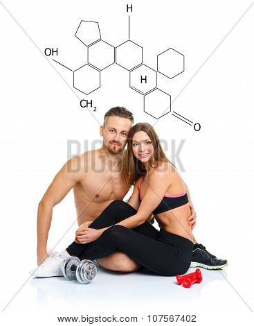 Athletic Couple - Man And Woman After Fitness Exercise Sitting With Dumbbells With The Chemical Form