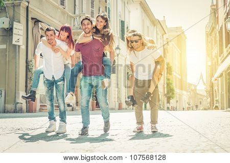 Group Of Friends Playing Around In The City Center