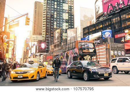 Yellow Taxi Cab And Rush Hour At Times Square In Manhattan New York