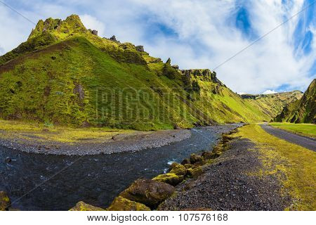 Scenic summer Iceland. The canyon Pakgil fast flowing shallow stream.  The photo was taken Fisheye lens
