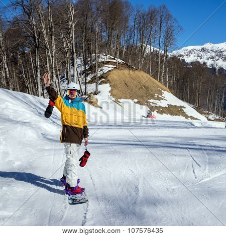 Young Woman Snowboarder In Mountains