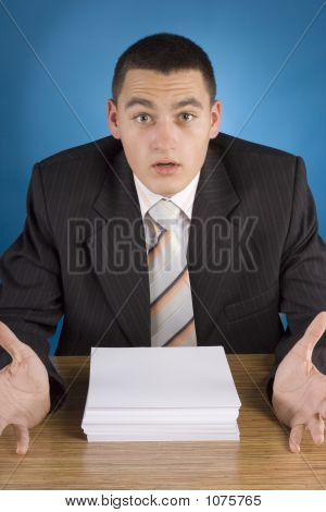Shocked Businessman At The Stack Of Documents