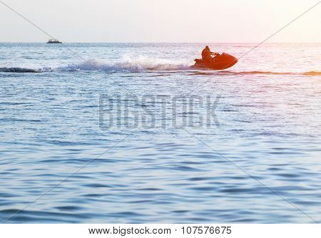 Silhouettes Of People In Motion On Jet ski