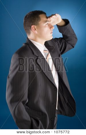 Young Businessman Watching - Hand At His Forehead