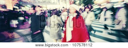 Blurred Large Crowd Walking in a City Cross Street Concept