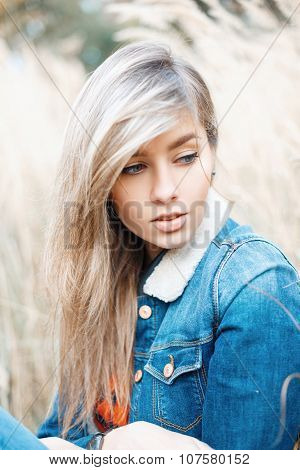 Close-up Portrait Of A Beautiful woman In A Denim Jacket