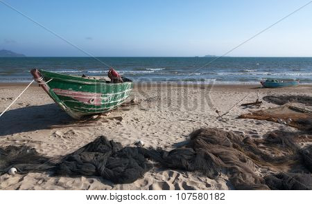 Boats and nets on the beach