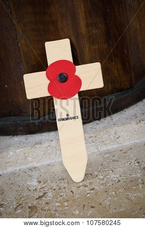 LONDON, UK - CIRCA JANUARY 2013: A poppy on a wooden cross at Bomber Command Memorial.