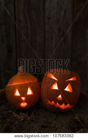 Carved Hokkaido Pumpkins In Mood Lighting For Haloween Holiday
