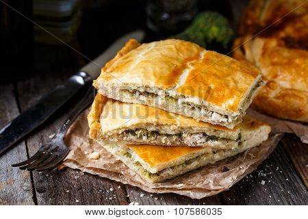 Homemade pie stuffed with chicken ang broccoli
