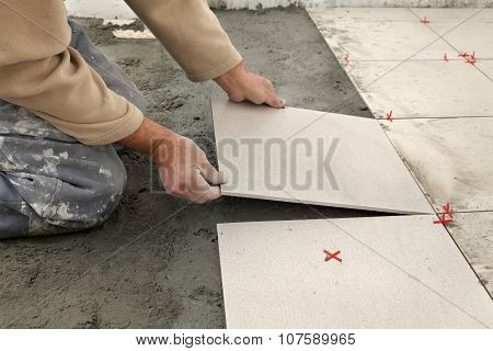 Home Renovation, Worker Placing Tile